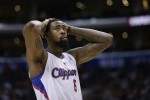 Los Angeles Clippers' DeAndre Jordan reacts to a foul call on his team during the second half of an NBA basketball game against the Dallas Mavericks on Thursday, April 3, 2014, in Los Angeles. The Mavericks won 113-107. (AP Photo/Jae C. Hong)